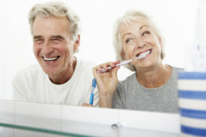 senior couple cleaning teeth