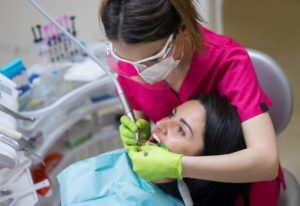person getting their teeth cleaned
