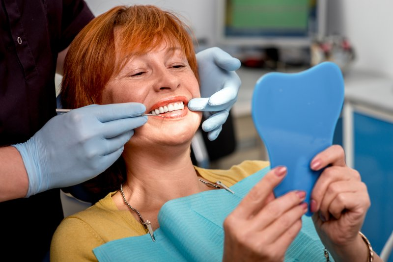 Woman with dental implant